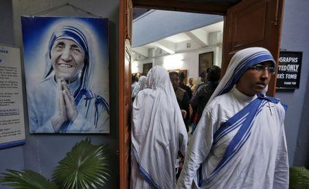 A Roman Catholic nun from the Missionaries of Charity, leaves a special mass held at Mother Teresa's tomb in Kolkata, India, March 15, 2016.  REUTERS/Rupak De Chowdhuri
