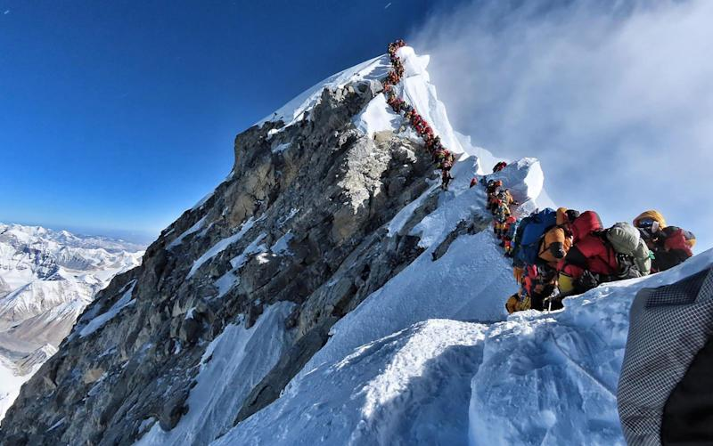 Many teams had to line up for hours on May 22 to reach the summit, as a rush of climbers marked one of the busiest days on the world's highest mountain - AFP