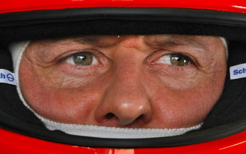 Michael Schumacher is 'conscious' after treatment in a Paris hospital, a French newspaper has claimed - AP