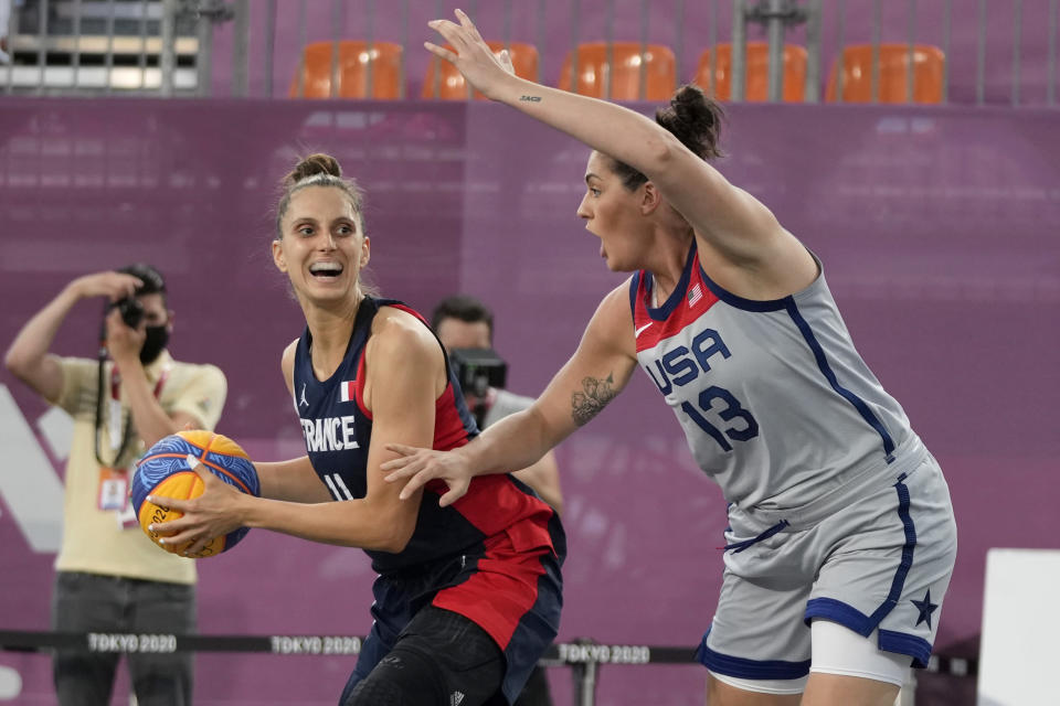 France's Ana Maria Filip (11) looks to pass as United States' Stefanie Dolson (13) defends during a women's 3-on-3 basketball game at the 2020 Summer Olympics, Saturday, July 24, 2021, in Tokyo, Japan. (AP Photo/Jeff Roberson)