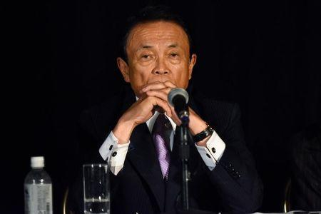 Japanese Finance Minister Taro Aso takes questions from reporters at the Willard Intercontinental hotel during the annual meetings of the IMF and World Bank Group in Washington