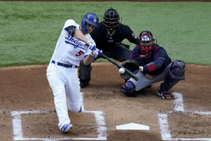 Los Angeles Dodgers' Corey Seager watches his home run against the Atlanta Braves during the first inning in Game 6 of a baseball National League Championship Series Saturday, Oct. 17, 2020, in Arlington, Texas. (AP Photo/Sue Ogrocki)