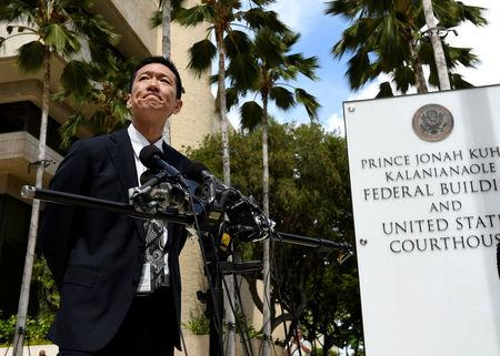 Hawaii Attorney General Douglas Chin answers questions from the media at the U.S. District Court Ninth Circuit after presenting his arguments after filing an amended lawsuit against President Donald Trump's new travel ban in Honolulu, Hawaii, March 15, 2017. REUTERS/Hugh Gentry