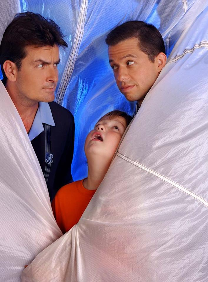 Charlie Sheen, Jon Cryer, and Angus T. Jones star in Two and a Half Men.