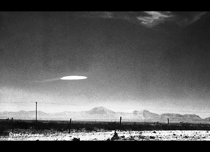 An unidentified flying object was photographed by a government employee over the Holloman Air Development Center in New Mexico in 1964. Conspiracy theorists have claimed the photo is proof that the U.S. government has been in contact with aliens.