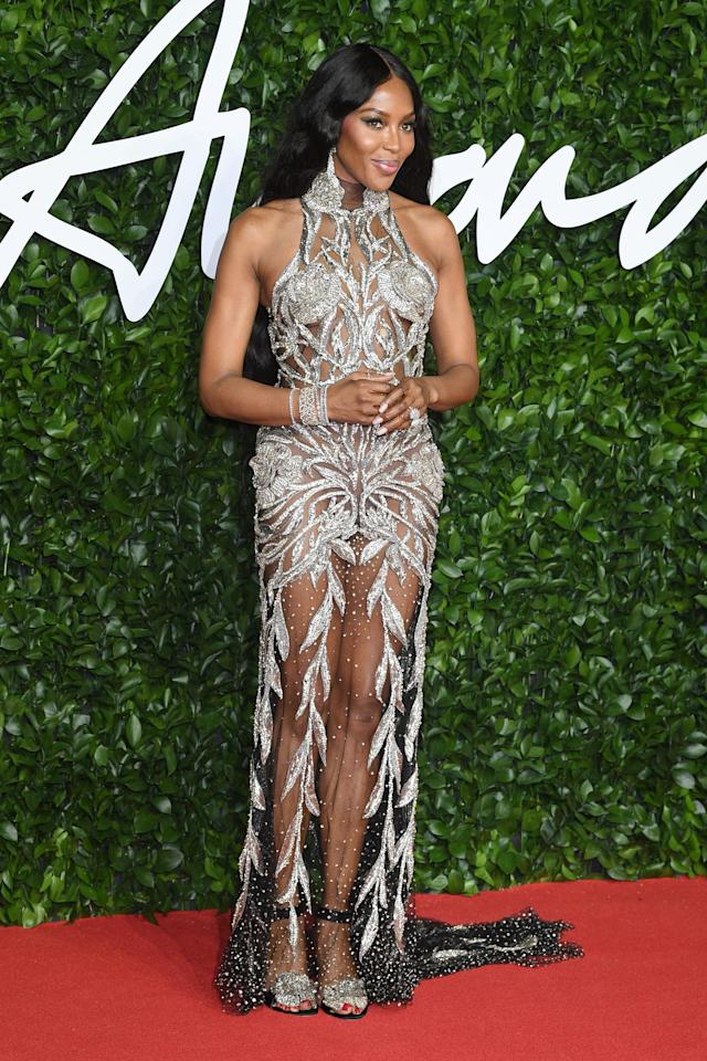 """<p><a class=""""sugar-inline-link ga-track"""" title=""""Latest photos and news for Naomi Campbell"""" href=""""https://www.popsugar.com/Naomi-Campbell"""" target=""""_blank"""" data-ga-category=""""Related"""" data-ga-label=""""https://www.popsugar.com/Naomi-Campbell"""" data-ga-action=""""&lt;-related-&gt; Links"""">Naomi Campbell</a> wearing a sheer, embroidered Alexander McQueen gown.</p>"""