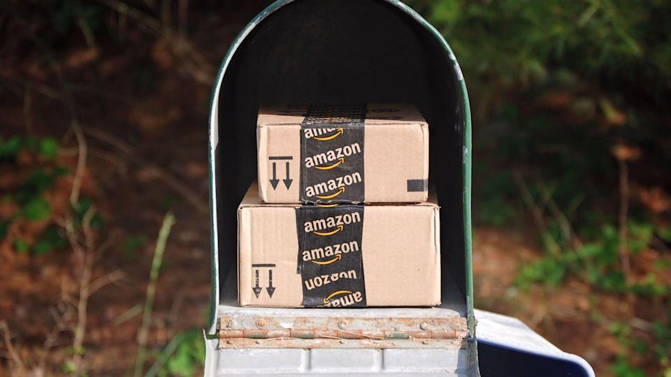 Amazon packages in the mailbox, as more people are buying online and causing stock value to increase.