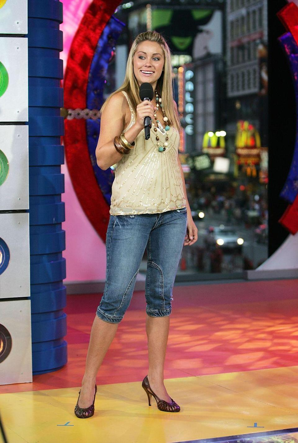 <p>Lauren Conrad was in the prime of her <em>Laguna Beach </em>fame when she appeared on <em>TRL. </em>Which explains why the reality star rocked her go-to half-up hairdo and waaaaay too many bangles. </p>
