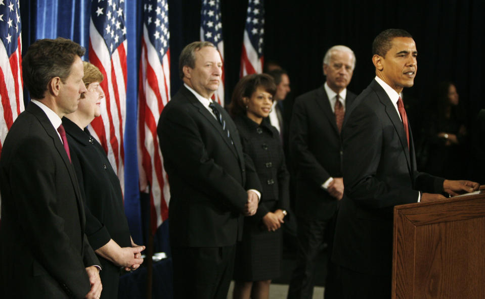 U.S. President-elect Barack Obama (R) unveils his economic policy team during a new conference in Chicago November 24, 2008. From left are Treasury Secretary-designate Timothy Geithner, Council of Economic Policy-designate Christina Romer, National Economic Council Director-designate Lawrence Summers, Domestic Policy Director-designate Melody Barnes, Vice President-designate Joe Bidenand Obama. REUTERS/Jeff Haynes    (UNITED STATES)