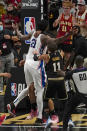 Philadelphia 76ers center Joel Embiid (21) and Atlanta Hawks forward John Collins (20) are separated after a brief altercations during the second half of Game 6 of an NBA basketball Eastern Conference semifinal series Friday, June 18, 2021, in Atlanta. (AP Photo/John Bazemore)