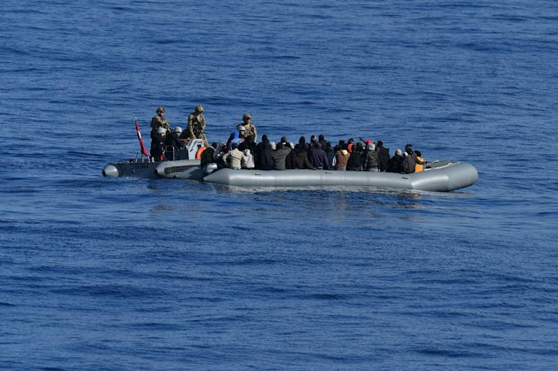 In this image provided by the Turkish Military, members of Turkish forces, left, approach migrants aboard a dinghy in the mid Mediterranean Sea, Wednesday, Jan. 29, 2020. The military said that a military ship, TCG Gaziantep, assisted the migrants and provided medical aid before handing them over to the Libyan Coast Guard. The frigate is in the region to support NATO's Mediterranean Shield Operation and to assist NATO's Marine Guard Operation. (Turkish Military via AP) (Photo: ASSOCIATED PRESS)