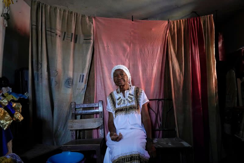 Follower of the Afro-Cuban religion Santeria sits before a ceremony amid concerns about the spread of the coronavirus disease outbreak in Havana