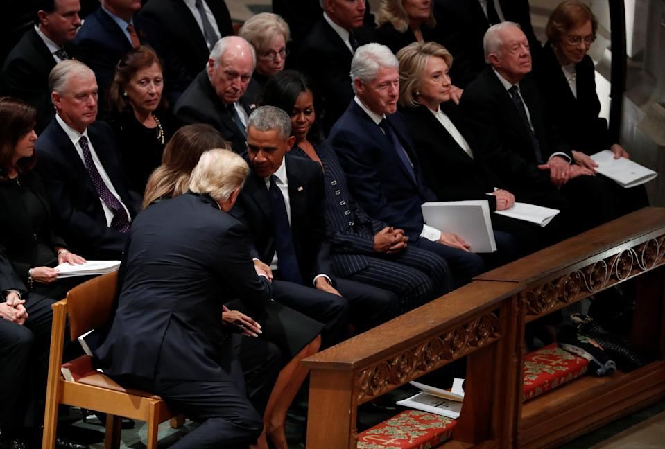 President Donald Trump reaches over to shake hands with former President Barack Obama as he takes his seat in the first row along with former first lady Michelle Obama, former President Bill Clinton and former first lady Hillary Clinton, former President Jimmy Carter and first lady Rosalynn Carter prior to the state funeral for former U.S. President George H.W. Bush at the Washington National Cathedral in Washington, D.C., Dec. 5, 2018. (Photo: Kevin Lamarque/Reuters)