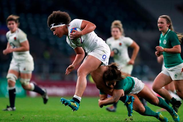 England's Shaunagh Brown is tackled by Ireland's Sene Naoupu