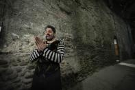 Singer and actor Yusif Eyvazov gestures as he answer questions to the Associated Press prior to perform in 'I Pagliacci' (The Clowns) lyric opera, at the Arena di Verona theatre, in Verona, Italy, Friday, June 25, 2021. The Verona Arena amphitheater returns to staging full operas for the first time since the pandemic struck but with one big difference. Gone are the monumental sets that project the scene to even nosebleed seats in the Roman-era amphitheater, replaced by huge LED screens with dynamic, 3D sets that are bringing new technological experiences to the opera world. (AP Photo/Luca Bruno)