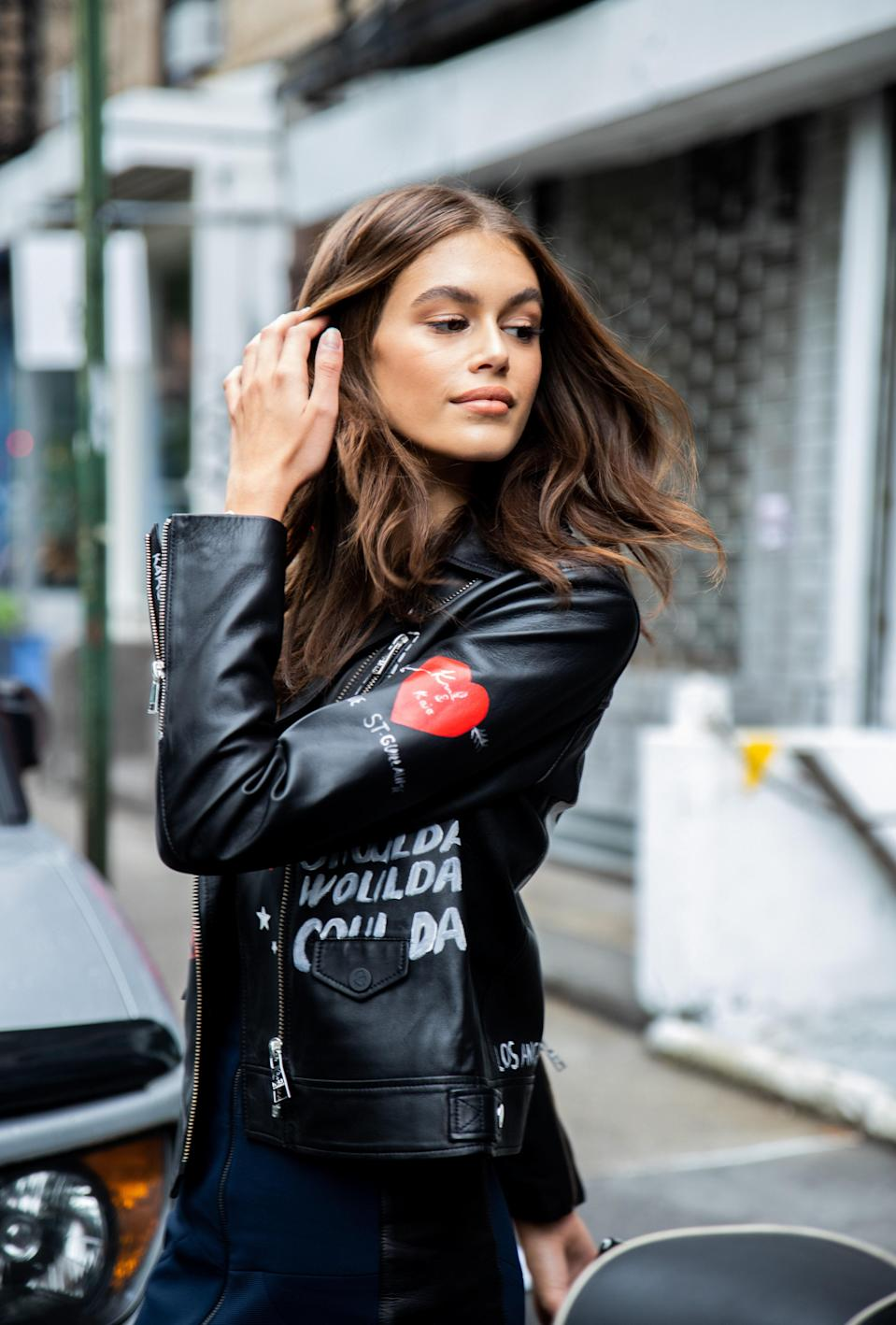 Wearing a leather jacket doesn't mean sticking to subdued styling and she proved that here.