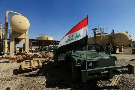 An Iraqi flag is seen on a military vehicle at an oil field in Dibis area on the outskirts of Kirkuk, Iraq October 17, 2017. REUTERS/Alaa Al-Marjani/Files
