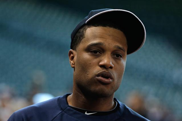 HOUSTON, TX - SEPTEMBER 27: Robinson Cano #24 of the New York Yankees works out on the field before the game against the Houston Astros at Minute Maid Park on September 27, 2013 in Houston, Texas. (Photo by Scott Halleran/Getty Images)