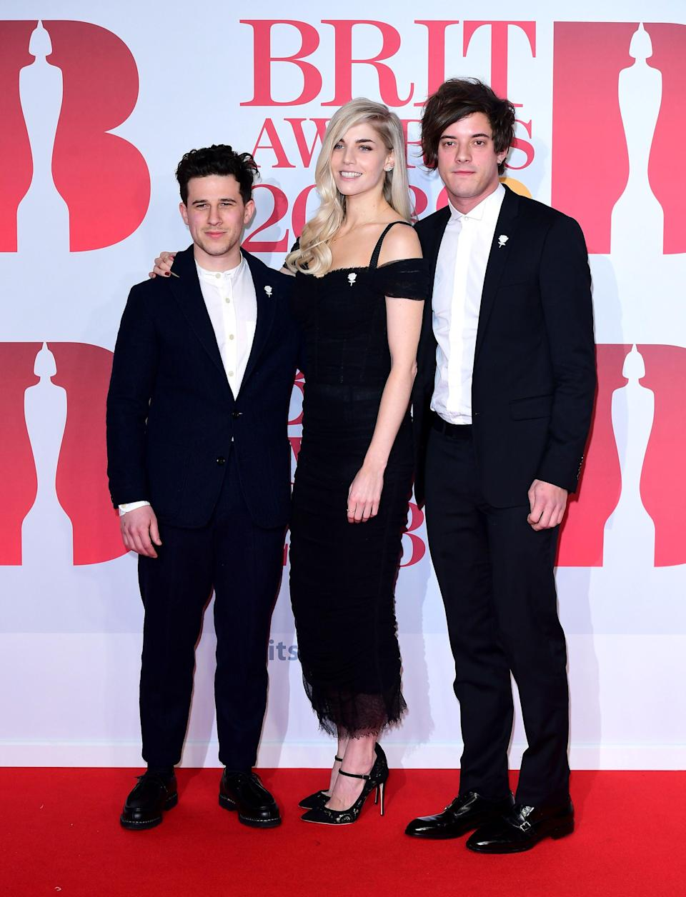 <p>London Grammar's Hannah Reid, Dan Rothman and Dominic 'Dot' Major attending the Brit Awards at the O2 Arena</p> (PA)
