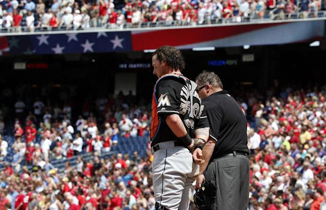Miami Marlins catcher Jarrod Saltalamacchia, and umpire Fieldin Culbreth pause for the National Moment of Remembrance during a baseball game against the Washington Nationals, at Nationals Park, on Memorial Day, Monday, May 26, 2014, in Washington. (AP Photo/Alex Brandon)
