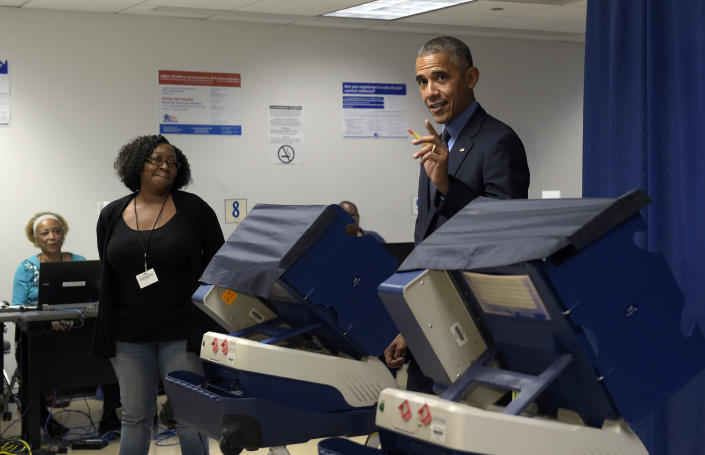 President Barack Obama casts his ballot at the Cook County Office Building in Chicago on Oct. 7, 2016. (Photo: Susan Walsh/AP)
