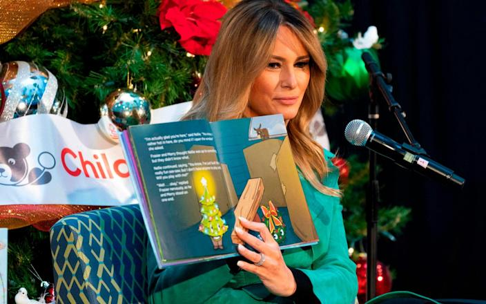 The First Lady removed her mask while reading to a group of children at the Children's National Hospital in Washington DC - JACQUELYN MARTIN/AFP