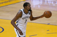 Brooklyn Nets forward Kevin Durant brings the ball up against the Golden State Warriors during the first half of an NBA basketball game in San Francisco, Saturday, Feb. 13, 2021. (AP Photo/Jeff Chiu)