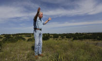 Andy Sansom walks on his property as he talks about a proposed new natural gas pipeline that would pass through his ranch in the Texas Hill Country near Stonewall, Texas Friday, Aug. 2, 2019. A proposed pipeline is a 430-mile, $2 billion natural gas expressway that pipeline giant Kinder Morgan has mapped from the booming West Texas oil patch to Houston. (AP Photo/Eric Gay)