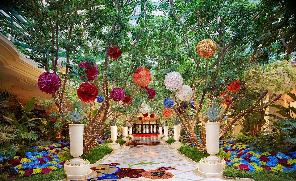 <p><strong>How did it strike you on arrival?</strong><br> This Strip favorite's gold-gilded peacock statues, red-trimmed pool cabanas, and enough fountains to rival the Romans, proves that Vegas Chic is not an oxymoron. When you walk into Wynn's main entrance, it's a totally otherworldly floral fantasy. You walk across floral mosaic tiles into a naturally lit lobby full of moving floral sculptures—like a flowery carousel surrounded by trees and giant floral bouquets hanging from the ceiling. There's a reason this is one of the city's most Instagrammed spots. You feel you've walked in off the Strip into an alternate universe. It manages to pull this off and feel magical—not cheesy.</p> <p><strong>What's the crowd like?</strong><br> It changes depending on who's having a business off-site or a convention at Wynn and Encore. But in general, guests are fashion- and status-conscious. They're here for the amazing retail (there are two Chanel stores), the restaurants, and the nightlife. There's no distinct demographic, but they're s more sophisticated and international crowd than in most other resorts on the Strip.</p> <p><strong>The good stuff: Tell us about your room.</strong><br> I stayed in a Wynn Deluxe King (there are a lot of room categories between Wynn and Encore), which is essentially the standard room at Wynn. The decor is all light woods, neutral and camel-colored carpets and lots of bright white touches where they're practical (like the bed), and this same decorating philosophy is true in most other rooms at Wynn. There are pops of color only in the art (you'll find good reproductions of modern masters) and in flowers. The floor-to-ceiling windows had a great view toward the Strip and west toward the mountains, an features include automated lights, drapes and sheers, with control panels right by the bed so you don't have to fumble around and try to figure out how to turn things on. The rooms are all quite large—generally starting at around 650 square feet.</p>