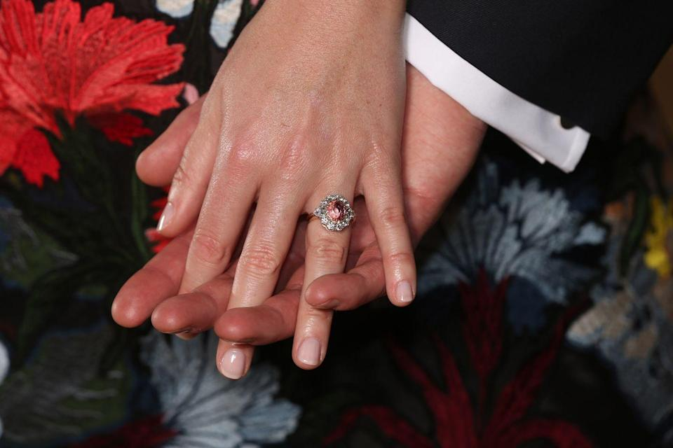 <p>While announcing their engagement, Princess Eugenie revealed her stunning Padparadscha Sapphire and diamond cluster ring. </p>