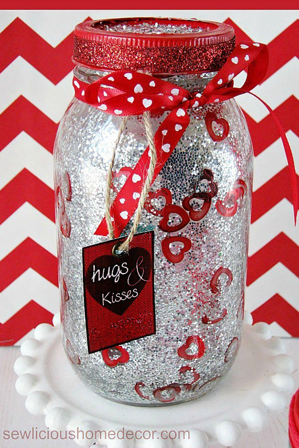 """<p><span class=""""redactor-invisible-space"""">Glitter addicts, this is the craft for you! Not only is it easy to make, supplies will cost you less than $5.</span></p><p><strong>Get the tutorial at <a href=""""http://sewlicioushomedecor.com/make-red-valentine-jars-glitter-confetti/"""" rel=""""nofollow noopener"""" target=""""_blank"""" data-ylk=""""slk:Sewlicious Home Decor"""" class=""""link rapid-noclick-resp"""">Sewlicious Home Decor</a>.</strong></p><p><a class=""""link rapid-noclick-resp"""" href=""""https://www.amazon.com/Topenca-Supplies-Inches-Double-Ribbon/dp/B01ENR4L4Q/ref=sr_1_1_sspa?tag=syn-yahoo-20&ascsubtag=%5Bartid%7C10050.g.93%5Bsrc%7Cyahoo-us"""" rel=""""nofollow noopener"""" target=""""_blank"""" data-ylk=""""slk:SHOP RED RIBBON"""">SHOP RED RIBBON</a></p>"""