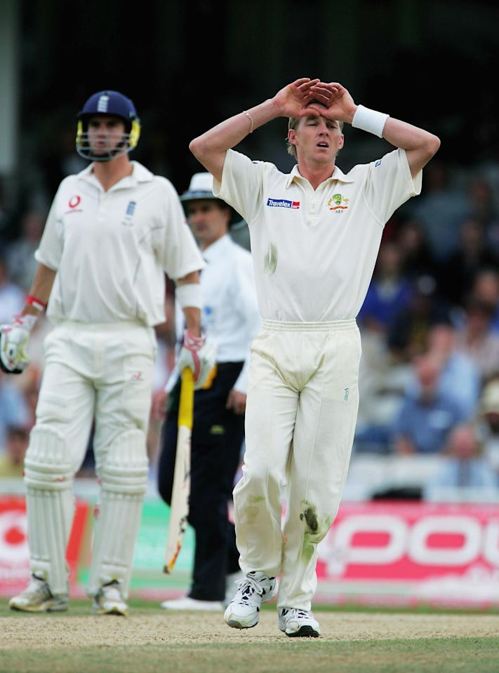 LONDON - SEPTEMBER 12:  Brett Lee of Australia holds his head after a missed chance during day five of the fifth npower Ashes Test match between England and Australia at the Brit Oval on September 12, 2005 in London, England.  (Photo by Clive Rose/Getty Images)