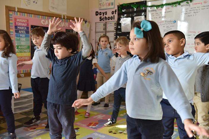 A kindergarten class does yoga at Helen I. Smith Elementary School, which uses mindfulness programs in its curriculum in Saddle Brook, N.J., on March 9.