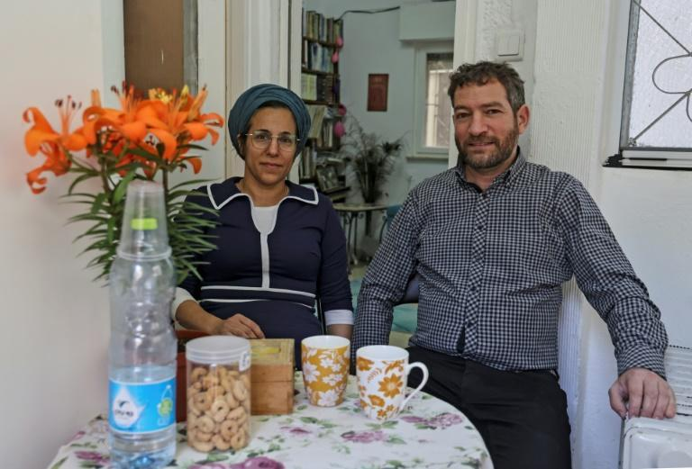 Naama Avidan and her husband Amiel pose with their children for a portrait at their home in Jerusalem, a place they allow ultra-Orthodox Jews to use part of for dating during the coronavirus lockdown
