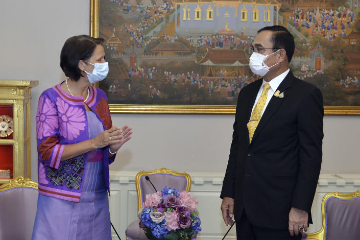 In this photo released by Government Spokesman Office, United Nations Special Envoy to Myanmar Christine Schraner Burgener, left, talks with Thailand's Prime Minister Prayuth Chan-ocha during a meeting at Government House in Bangkok, Thailand, Friday, May 14, 2021. (Government Spokesman Office via AP)