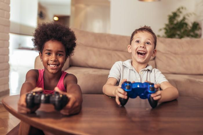 A boy and a girl playing video games.