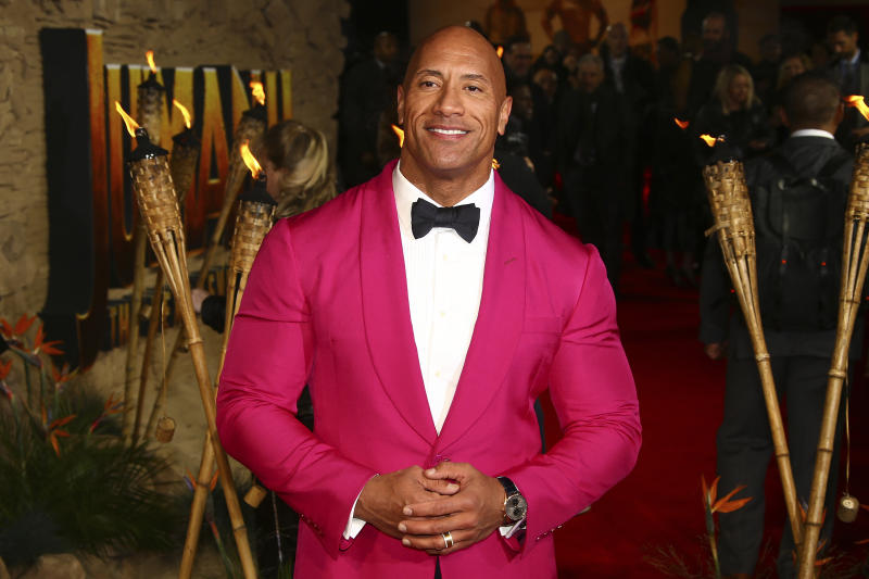 Actor Dwayne Johnson poses for photographers upon arrival at the premiere of the film 'Jumanji The Next Level', in central London, Thursday, Dec. 5, 2019. (Photo by Joel C Ryan/Invision/AP)