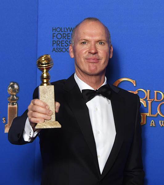 "Michael Keaton with the award for Best Actor - Motion Picture, Comedy or Musical for his role in ""Birdman"" at the 72nd annual Golden Globe Awards, January 11, 2015 in Beverly Hills, California (AFP Photo/Frederic J. Brown)"