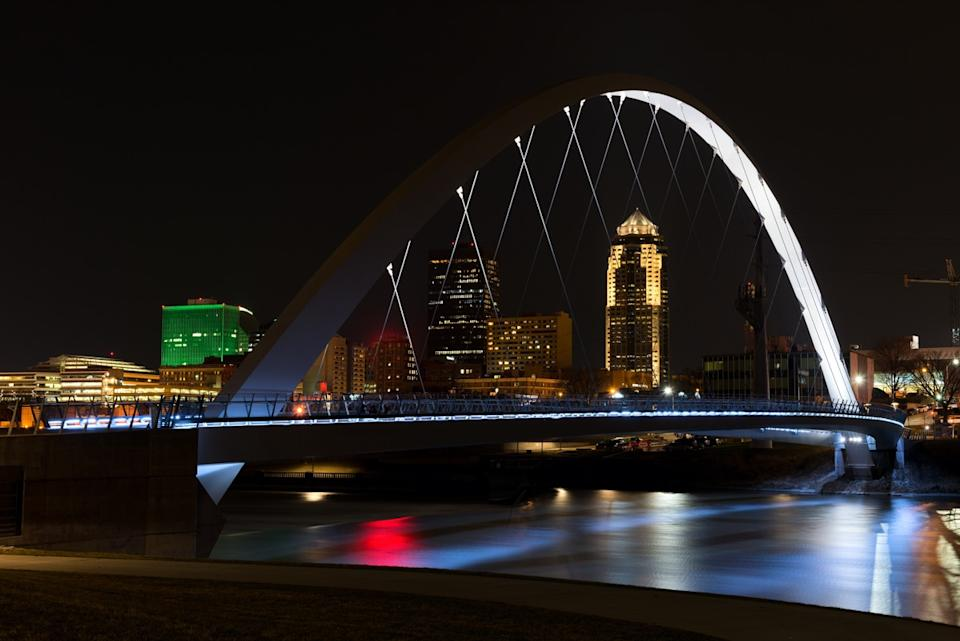 Downtown Des Moines Riverwalk Bridge At Night. Des Moines Iowa