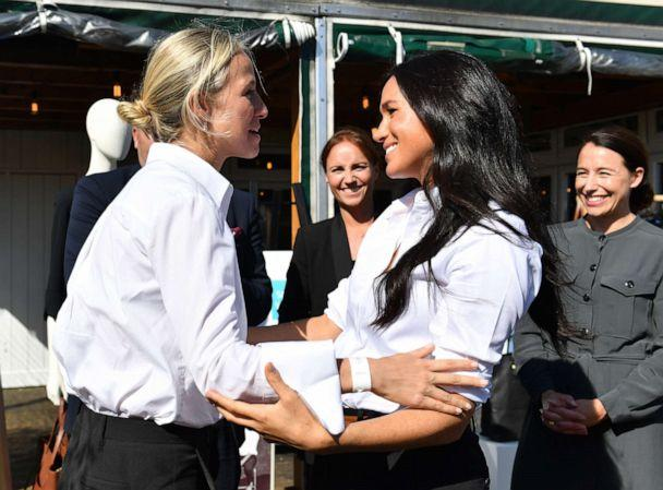 PHOTO: Meghan, Duchess of Sussex embraces designer Misha Nonoo as she launches the Smart Works capsule collection on September 12, 2019 in London, England. (Wpa Pool/Getty Images)