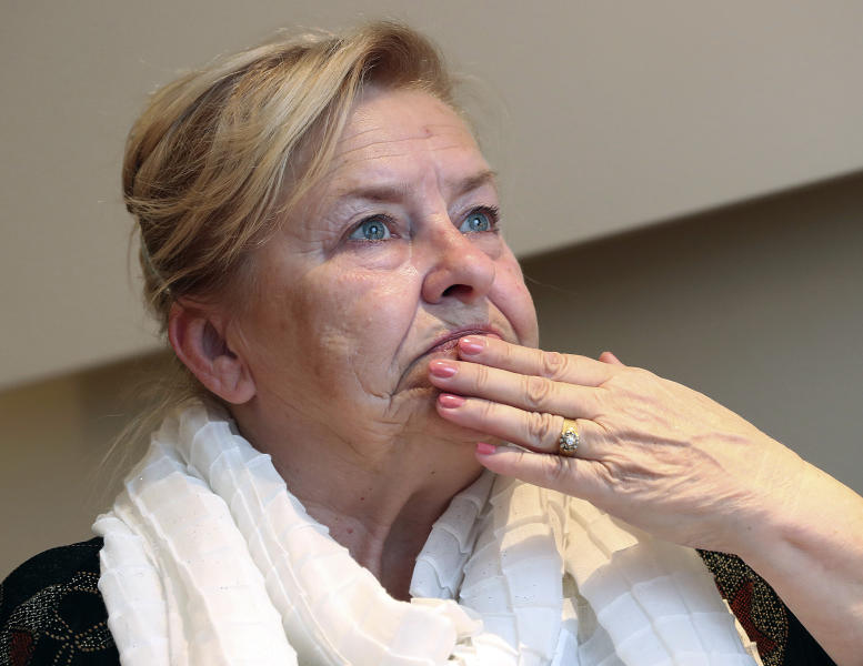 In this photo taken on May 15, 2019, Barbara Borowiecka, a survivor of alleged abuse as a minor by a prominent Solidarity-era priest gestures during an interview with The Associated Press. A documentary film with testimony by victims of clerical abuse in Poland is so harrowing that it has forced an unprecedented reckoning with the problem in one of Europe's most deeply Catholic societies. In December, Borowiecka, 62, told Polish media about being abused when she was 11 by Henryk Jankowski, a prominent prelate in Lech Walesa's anti-communist Solidarity movement in Gdansk, where a monument of him stood. (AP Photo/Czarek Sokolowski)