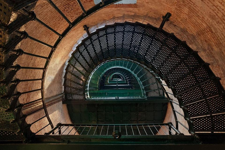 <p>This North Carolina spot is one of several guarding the Outer Banks, and its got some pretty wrought iron steps.</p>