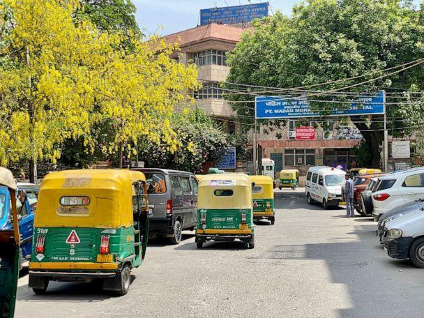 PHOTO: A line of auto-rickshaws sits outside a busy hospital in New Delhi. (Maggie Rulli/ABC News)