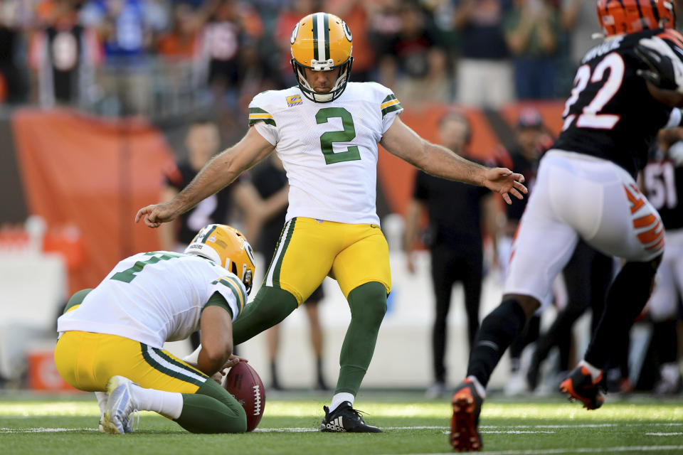Green Bay Packers kicker Mason Crosby (2) kicks the winning field goal in overtime for a final score of 25-22 during an NFL football game against the Cincinnati Bengals, Sunday, Oct. 10, 2021, in Cincinnati. (AP Photo/Emilee Chinn)