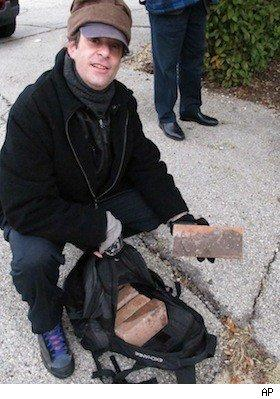 Tom Sclar holds brick from Lee Harvey Oswald's apartment building.