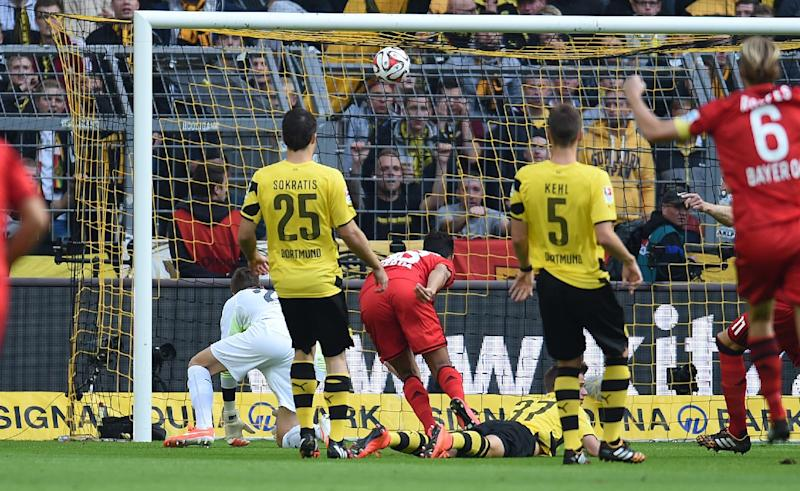 Leverkusen's forward Karim Bellarabi (3-L) scores against Dortmund's Australian goalkeeper Mitchell Langerak during the German first division Bundesliga football match in Dortmund on August 23, 2014