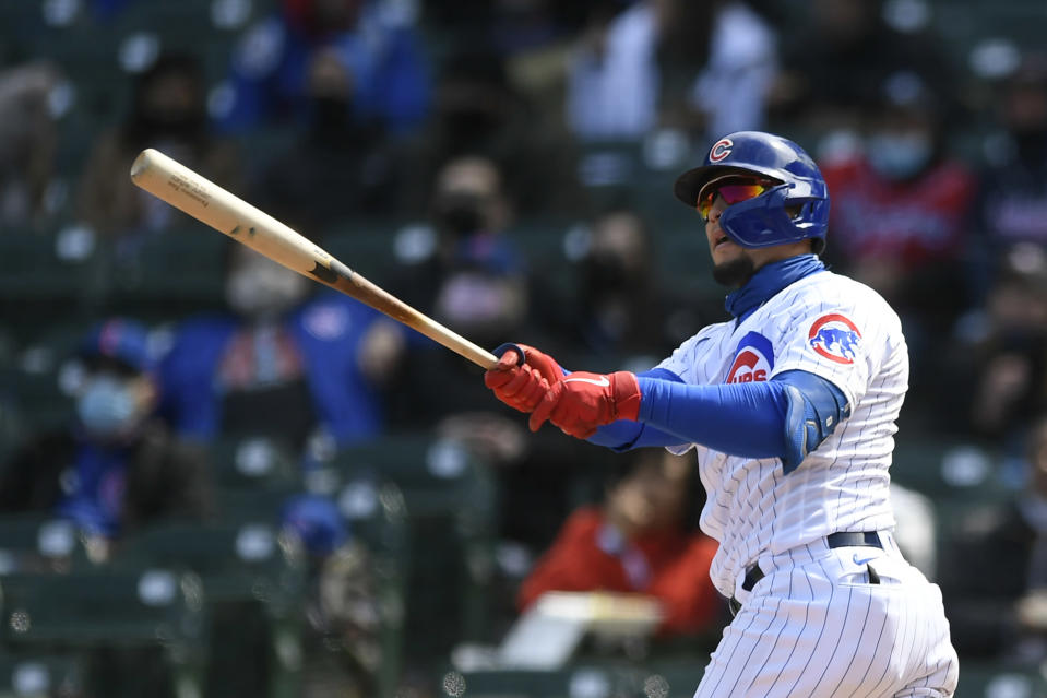 Chicago Cubs Javier Baez watches his three-run home run during the third inning of a baseball game against the Atlanta Braves Saturday, April 17, 2021, in Chicago. (AP Photo/Paul Beaty)
