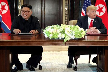U.S. President Donald Trump and North Korea's leader Kim Jong Un hold a signing ceremony at the conclusion of their summit at the Capella Hotel on the resort island of Sentosa, Singapore June 12, 2018. Picture taken June 12, 2018. REUTERS/Jonathan Ernst/Files