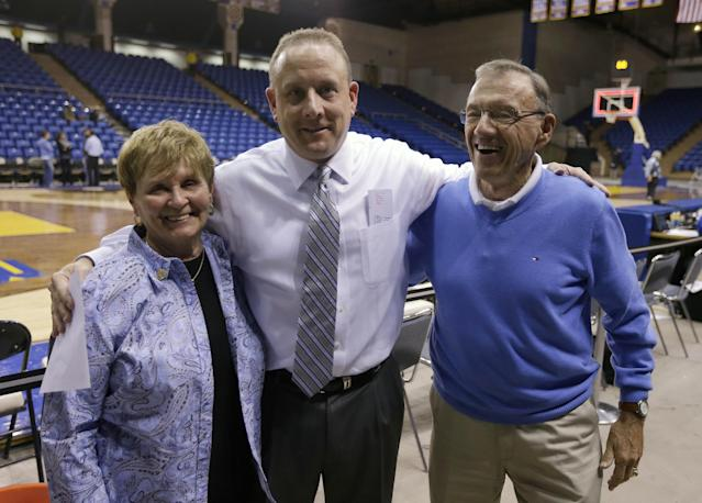 In this Nov. 6, 2013 photo, San Jose State coach Dave Wojcik, center, hugs his parents Martha Wojcik, left, and Fred Wojcik after the basketball game against Pacific Union, in San Jose, Calif. Wojcik has made so many stops criss-crossing the country for work he began to wonder if he would ever get to be a head coach. On Tuesday night, Nov. 12, 2013, he makes his debut at last when his San Jose State team opens the season at Santa Clara. (AP Photo/Ben Margot)