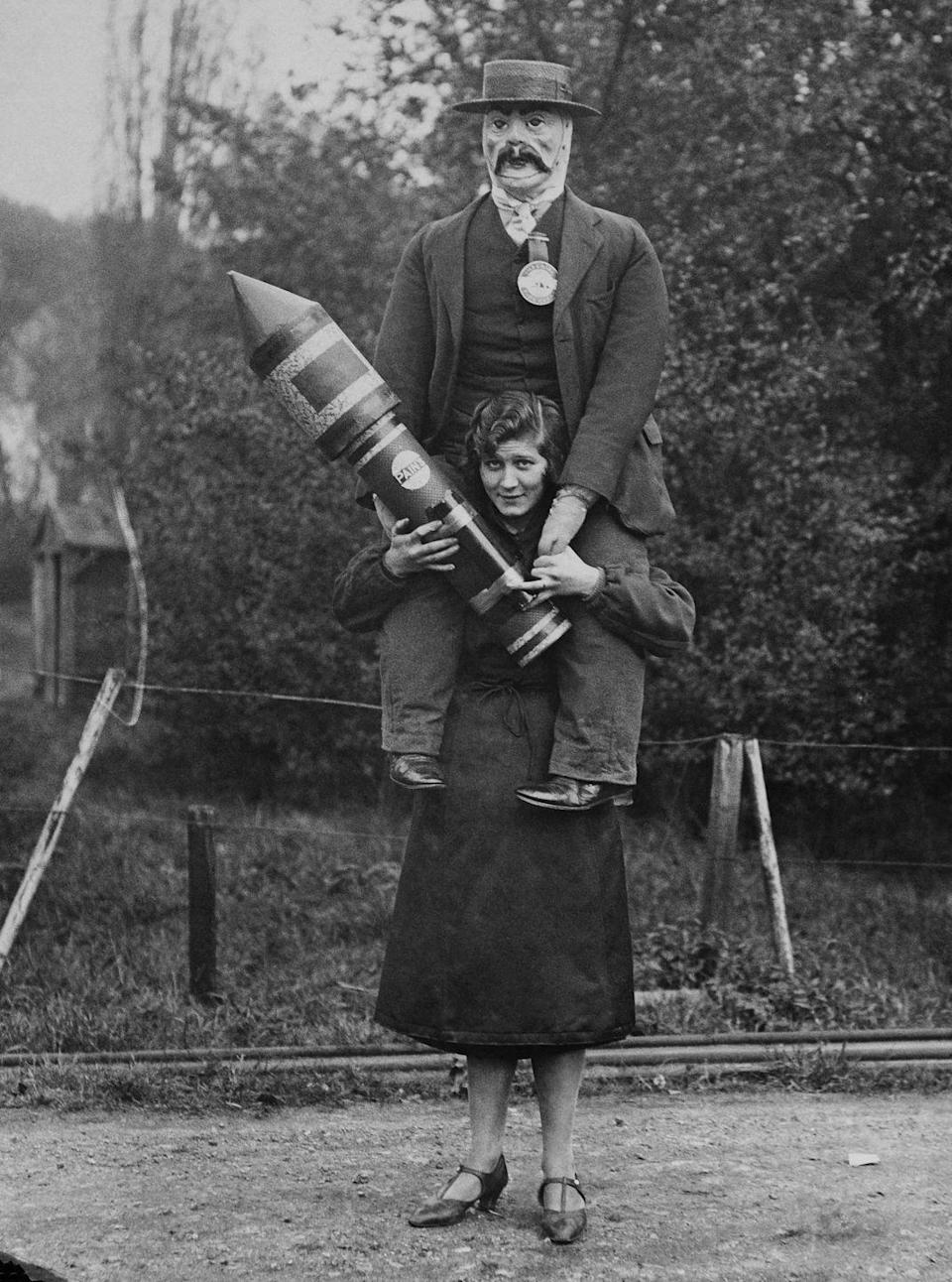 <p>Not entirely sure what this fireworks employee is doing with a dummy on her back, but if I had to see this cursed image, so do you.</p>